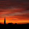 Silhouetted sunset view of the towering steeple of the St. Phillip's Episcopal Church and city skyline in downtown Charleston, SC on Friday, February 27, 2015. Copyright 2015 Jason Barnette